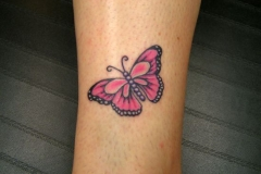 Small-butterfly-tattoo-above-the-ankle