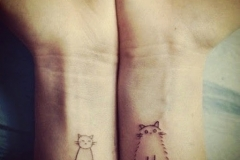 small and fat cat tattoos on wrist