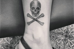 Small-Skull-Tattoo-On-Foot