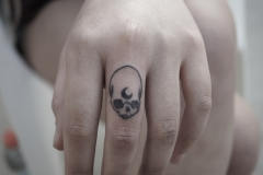 skull-moon-tattoo-on-finger
